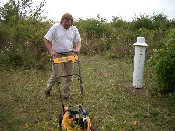 Andy working; in the background the rain gauge